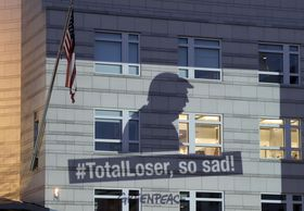 A Greenpeace banner showing U.S. President Donald Trump and the slogan '#TotalLoser, so sad!' is projected onto the facade of the U.S. Embassy in Berlin, Germany, June 2, 2017, photo: CTK