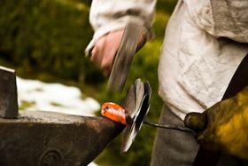 Jan - the Christmas Blacksmith Reenactor - making iron rose, photo: Vít Pohanka