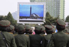People watch a broadcast of the test-fire of an inter-continental ballistic rocket Hwasong-12, August 30, 2017, Pyongyang, North Korea, photo: CTK