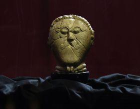 Sculpted limestone head from Mšecké Žehrovice, photo: ČTK/Krumphanzl Michal