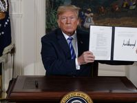 Donald Trump shows a signed Presidential Memorandum after delivering a statement on the Iran nuclear deal, photo: CTK