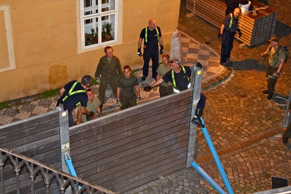 Steven Ludwig – Resilience.  We planned our storybook vacation to Prague this year.  Unknown to us, the floods would come, but we went anyway.  Although we missed certain sites, we gained by observing the resilience of the Czech people.  Here, happy workers taking down a flood barrier.