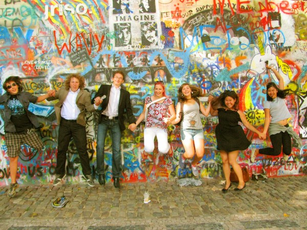 Berlina Andrea Yu – (At the Lennon Wall in Prague) I worked at a camp in Stara Ves for 3 mos. When camp ended & I was to return to my country, my students (all from different parts of CZ) visited & took me around Prague! I really loved that day because my students became my friends, and I got to see the city through their eyes. This photo proves that race or language is never a barrier for friendships to form :)