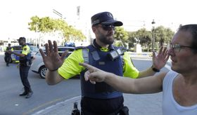 Police officers tell members of the public to leave the scene in a street in Barcelona, August 17, 2017, photo: CTK
