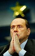 Italský premiér Silvio Berlusconi hovoří na tiskové konferenci na závěr summitu Evropské unie vBruselu, Foto: CTK