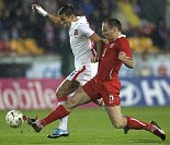 Czech Republic's Milan Baroš (left) fights for a ball with Arkadiusz Glowacki of Poland, photo: CTK