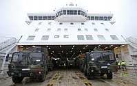 German Military trucks and other vehicles for the 'Patriot' defense missiles are loaded onto the Danish ferry in the harbor of Luebeck, January 8, 2013, photo: CTK