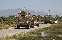 A NATO armored truck tows a vehicle damaged in a suicide attack in the Parwan province, Afghanistan, July 8, 2014, photo: CTK
