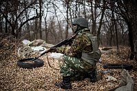 Ukrainian serviceman gets ready to fire near Trehizbenka village, Ukraine, November 23, 2014, photo: CTK