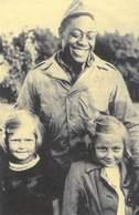 An American soldier with children in Plzen