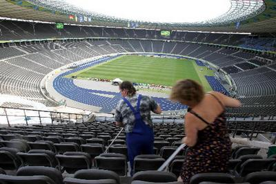 Maintenance workers cleans the Berlin's Olympic stadium Friday, July 7, 2006 as they prepare the sta