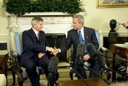 US President George W. Bush (R) meets with Polish Prime Minister Marek Belka (L) in the Oval Office of the White House in Washington, DC