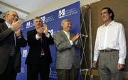 Craig C. Mello, a professor from the University of Massachusetts Medical School in Worcester, Mass. is congratulated by Aaron Lazare, chancellor and dean of the medical school, left