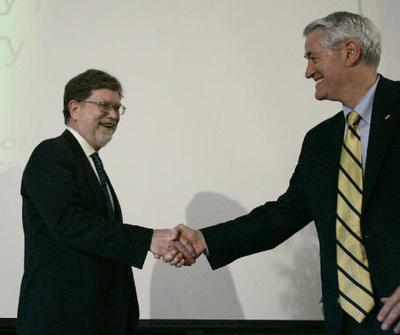 Dr. George Smoot, Professor of Physics at the University of California Berkeley, left, is congratula