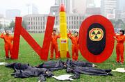 Members of Korean Federation for Environmental Movement perform a skit during a rally denouncing North Korea's nuclear test in Seoul, Wednesday, Oct. 11, 2006 (AP Photo/Ahn Young-joon)