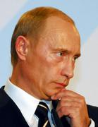 Vladimir Putin, President of Russia, listens during a press conference in Dresden, Germany, Tuesday, Oct. 10, 2006 (AP Photo/Matthias Rietschel)