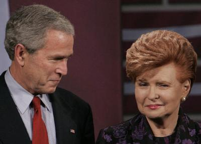 US President George W. Bush poses with Latvian President Vaira Vike-Freibera, before addressing gues