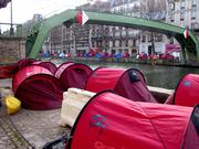 The Children of Don Quixote set up hundreds of red tents for homeless people
