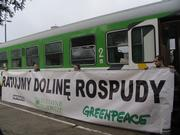 "Activists with banner saying ""Save the Rospuda valley"""