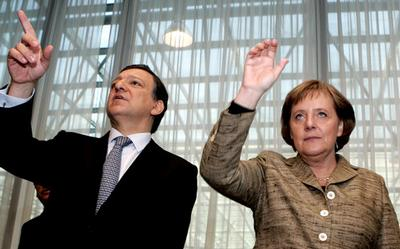 German Chancellor Angela Merkel, right, gestures while speaking with European Commission President J