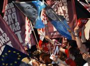 upporters of French socialist presidential candidate Segolene Royal wave flags during her last campaign meeting in Toulouse