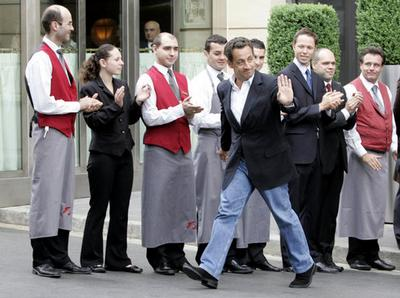 French President-elect Nicolas Sarkozy waves to supporters while leaving a hotel in Paris, Monday Ma