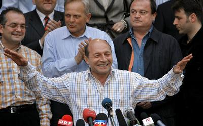 Romania's suspended President Traian Basescu reacts shortly after exit polls of a referendum showed
