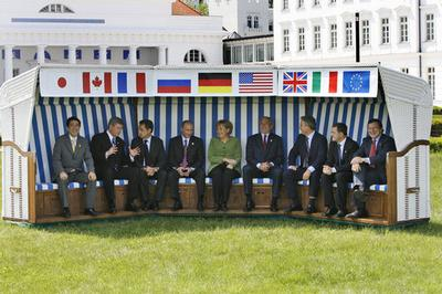 World leaders enjoy a chat in a giant beachchair at historic Heiligendamm during the G8 summit