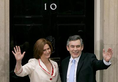 Britain's newly appointed Prime Minister Gordon Brown, right, and his wife Sarah wave as they pose o
