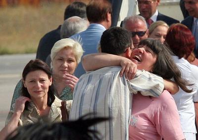 Bulgarian nurses hug their relatives at Sofia airport