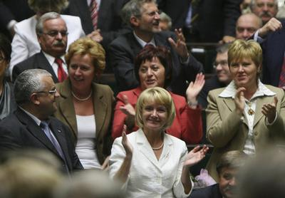 Lawmakers from the ruling Law and Justice party react after a vote to dissolve the parliament during