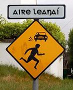 "Roadsign in Irish reading ""Caution Children"""