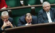 Members of the opposition Law and Justice party with former Prime Minister Jaroslaw Kaczynski, right, listen in the parliament, as Donald Tusk, presents his cabinet's plans