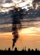 The Pitesti petro-chemical plant, 100 kilometers north of Bucharest, Romania, releases smoke into the atmosphere at sunset