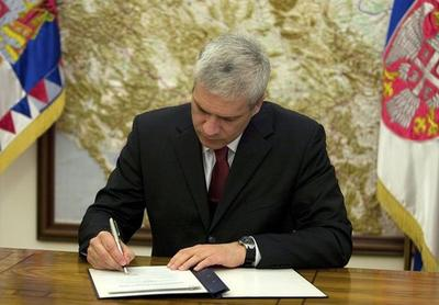 Serbia's president Boris Tadic signs document to dissolve parliament and schedule early elections