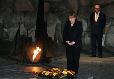 German Chancellor Angela Merkel laying a wreath at the Hall of Remembrance during a visit to the Yad