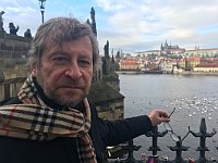 Architect and writer Zdeněk Lukeš by Charles Bridge, photo: Ian Willoughby