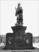 The statue of St John of Nepomuk on Charles Bridge
