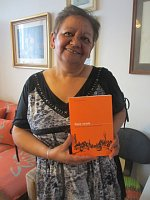 Irena Eliášová with the book 'Naše osada' – Our Settlement, photo: David Vaughan