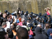 Riot police advancing on a demonstration against the neo-Nazi march