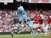 West Ham's Cheikhou Kouyate heads the ball to score his sides first goal during the match between Arsenal and West Ham, photo: CTK