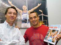 Photographer Herbert Slavik and Roman Sebrle with the book Athens 2004, photo: CTK