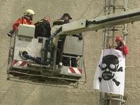 Police and firefighters use the high-lifting platform to bring down one of the  Greenpeace activists, photo: CTK
