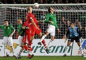 Jan Koller, center left, gets in a header against Ireland, photo: CTK