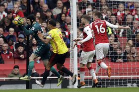 Petr Čech, left, makes a save in front of Watford's Troy Deeney during the English Premier League soccer match between Arsenal and Watford, photo: CTK