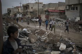 Iraqi civilians walk on the streets of a recently liberated neighborhood in western Mosul, March 13, 2017, photo: CTK