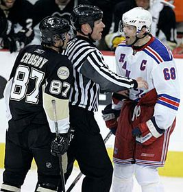 Jaromir Jagr of the Czech Republic yells at Pittsburgh Penguins Sidney Crosby as they are separated by linesman Brian Murphy in first period NHL playoff hockey action in Pittsburgh, photo: CTK
