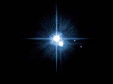 Pluto and its moons taken by the Hubble space telescop, photo: CTK