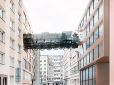 Visualisation of the walkway in the form of a nineteenth-century train crashing through one building into another, photo: Archive of David Černý