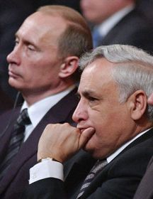 Vladimir Putin y Mosze Kacaw (Foto: CTK)